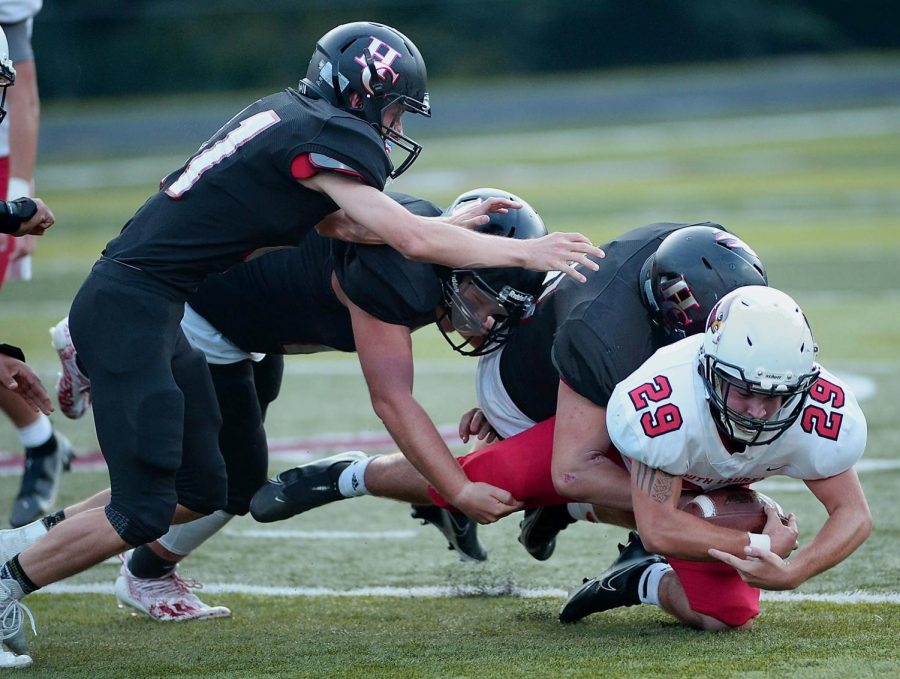 Several Harlan County defenders brought down South Laurel running back Brad Elza in Fridays game. The Bears held South to five yards on the ground.