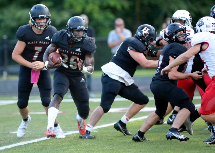 Harlan County senior tailback Demarco Hopkins took the handoff from quarterback Ethan Rhymer on a sweep in Fridays game against South Laurel. Hopkins ran for 291 yards and five touchdowns in the Bears 59-26 victory.