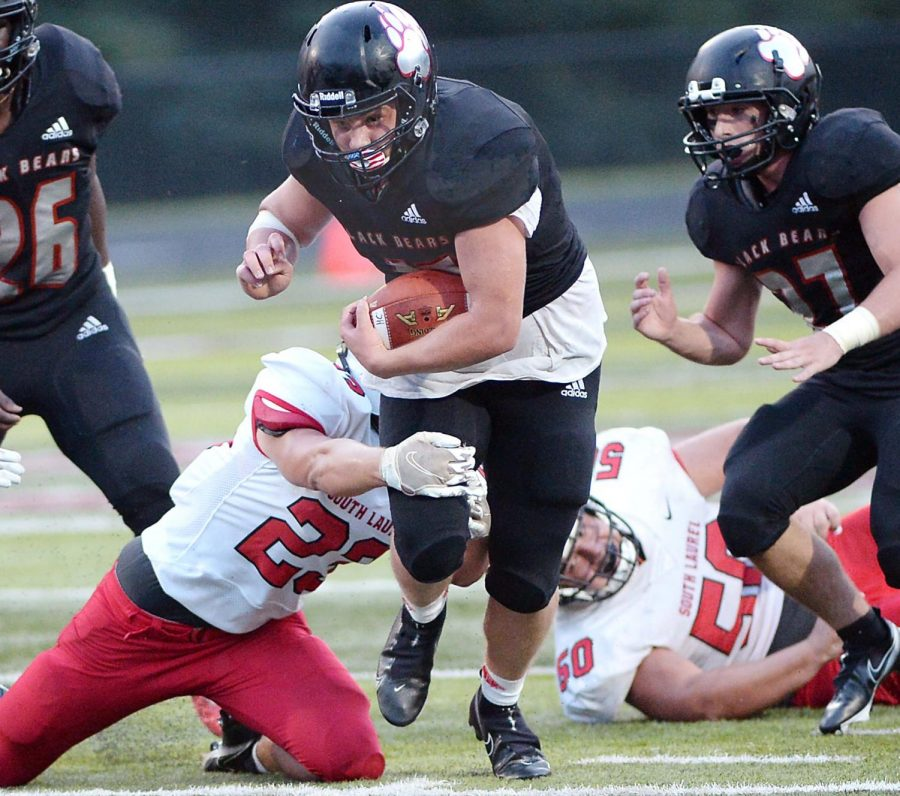Harlan+County+running+back+Josh+Sergent+broke+a+tackle+in+a+win+over+South+Laurel+earlier+this+season.+Sergent+and+the+Bears+return+to+action+Monday+at+Clay+County.