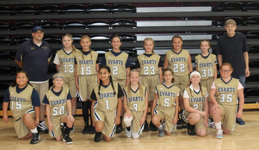 Team members include, from left, front row: Sadie Woodard, Brooklyn Middleton, Madison Vick, Audrianna Stewart, Macie Sizemore, Josie Thomas and Serenity Thomas; back row: coach James Smith, Rylee Napier, Shawnee Peace, Khloe Carr, Octavia Wright, Crissalyn Jones, Rylie Griffith and coach Glenn Ford.