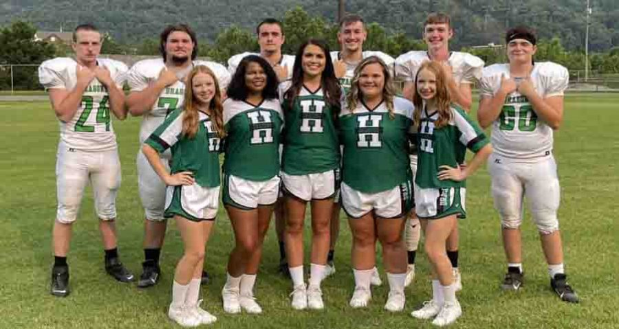 Harlan High School seniors in football and cheerleading posed for a photograph during media day activities Friday. Cheerleaders included, from left, Hannah Amburgey, Alisha Prince, Lily Dickenson, Emma Eversole and Rachel Amburgey. Football seniors included Jared Eldridge, Jonathan Lewis, Triston Cochran, Cade Middleton, Evan Browning and Andrew Roark.