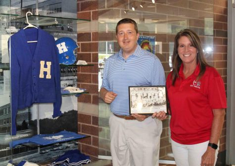 A photo of Halls 1955 baseball team, which won a regional title and finished second in the state tournament, was added to the memorabilia section at Harlan County High School in the front entrance at the school. HCHS Principal Kathy Napier and athletic director Eugene Farmer placed the photo with other items connected to Hall High School.