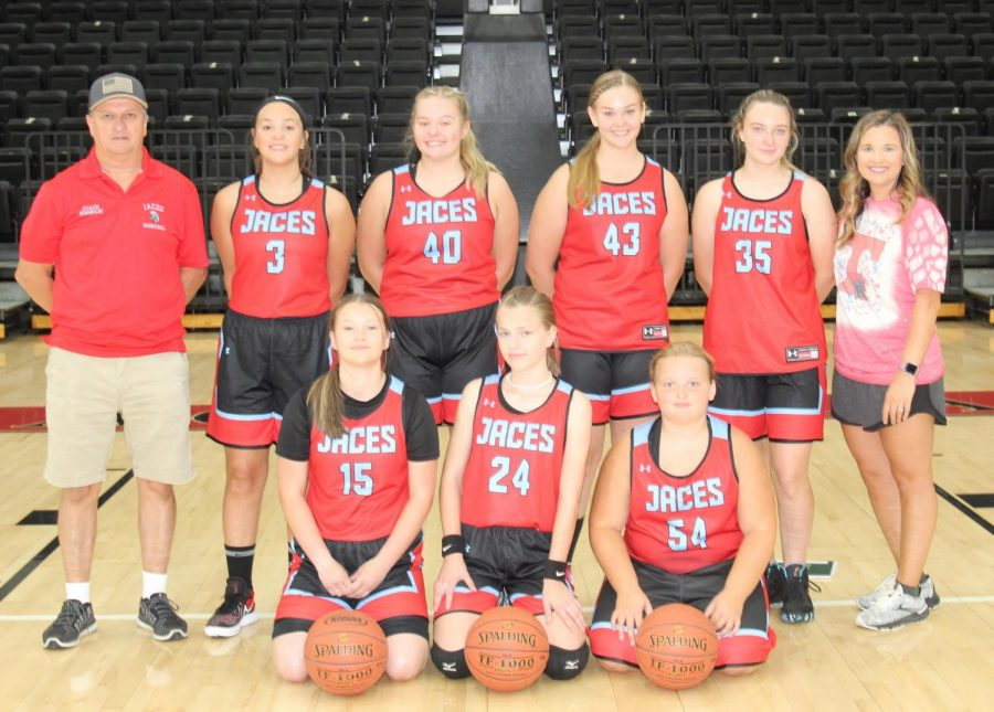 Team members include, from left, front row: Abby Elliott, Kelly Wright and Whitney Bray; back row: coach Tim Engle, Kaylissa Daniels, Lacy Robinson, Hayley Ward, Jaiden Marlowe and coach Shelby Engle.