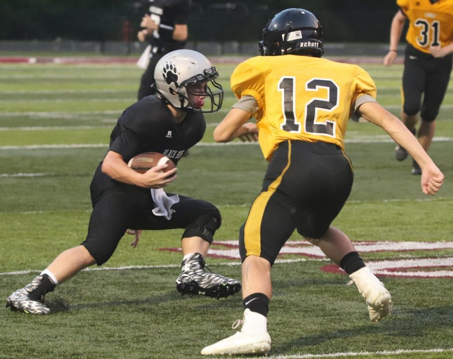 Jayce Brown, an eighth-grade running back, made a move in Thursday's eighth-grade game against Clay County. The visiting Tigers won 14-8.