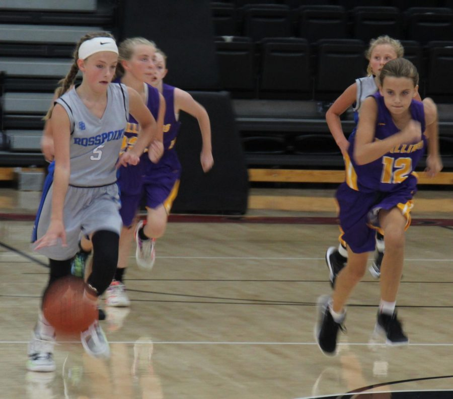 Rosspoints Lauren Lewis raced down the court as Wallins Kylie Runions gave chase in the championship game Saturday of the Black Bears Preseason Tournament.