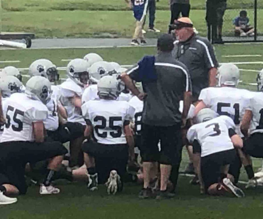 Harlan+County+coach+Scott+Caldwell+talked+with+the+Black+Bears+before+their+games+against+Danville+on+Saturday.+Harlan+County+won+36-0+in+the+seventh-grade+game+and+lost+34-20+in+eighth-grade+action.