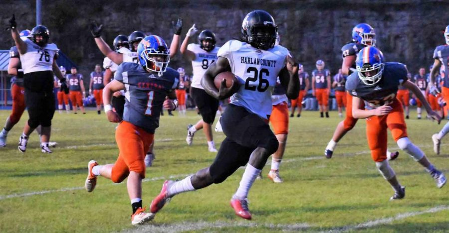 Harlan County running back Demarco Hopkins headed for one of his six touchdowns Friday at Pike Central as several offensive lineman celebrated behind him. The Bears gained over 400 yards rushing in a 60-38 win.