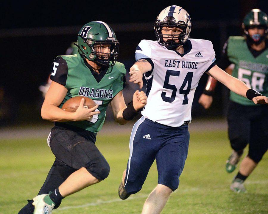 Harlan senior quarterback Cade Middleton broke free for a big gain during Fridays win over visiting East Ridge.