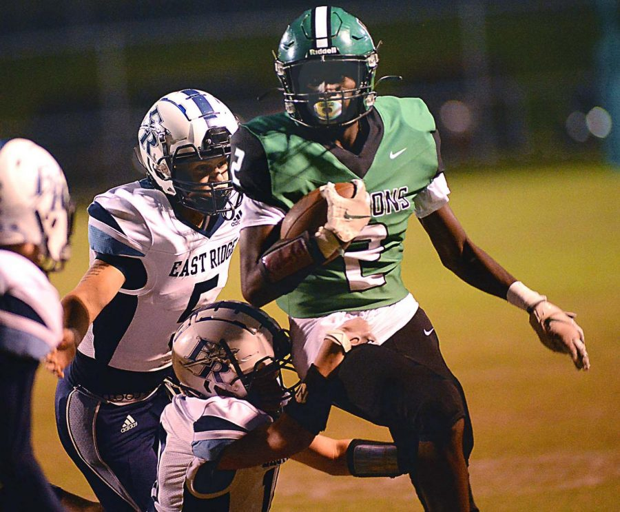Harlan receiver Darius Akal battled his way deep into East Ridge territory during Fridays game. The Green Dragons rallied from an early 22-0 deficit to win 46-40.