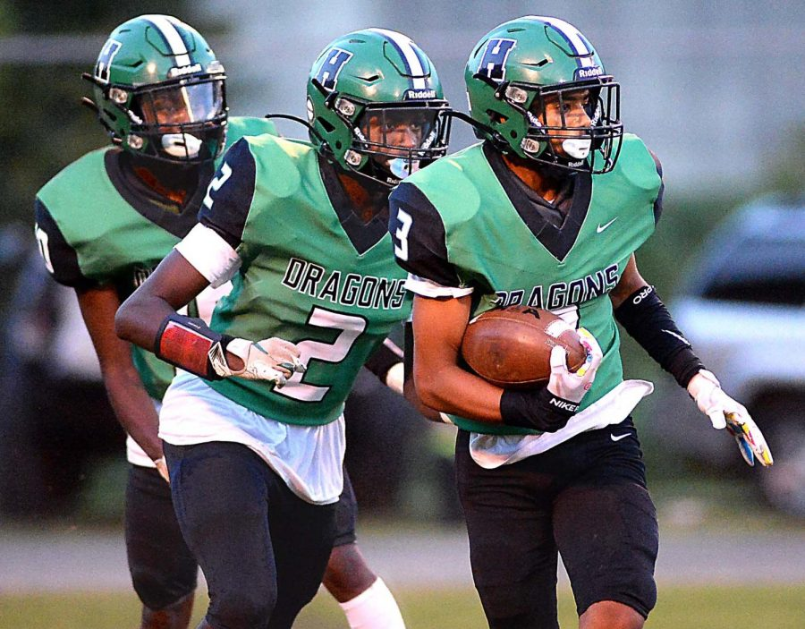 Harlans Donovan Montanaro looked for running room during the Green Dragons 46-40 win over visiting East Ridge.