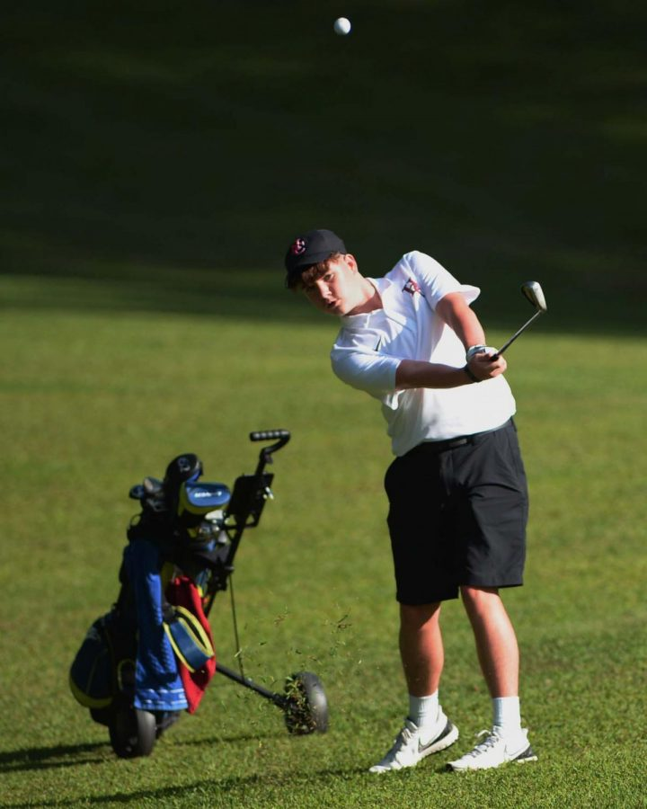 Harlan Countys Evan Simpson watched the flight of his shot in Thursdays tournament at the Harlan Country Club.