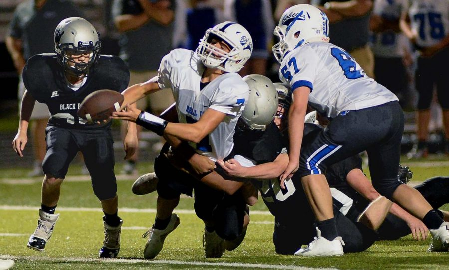 Harlan+County+linebacker+Shemarr+Carr+brought+down+a+Bell+County+ball+carrier+in+Thursday%E2%80%99s+middle+school+game.+Carr+scored+the+winning+touchdown+with+10+seconds+left+as+the+Bears+edged+the+Bobcats+28-22.