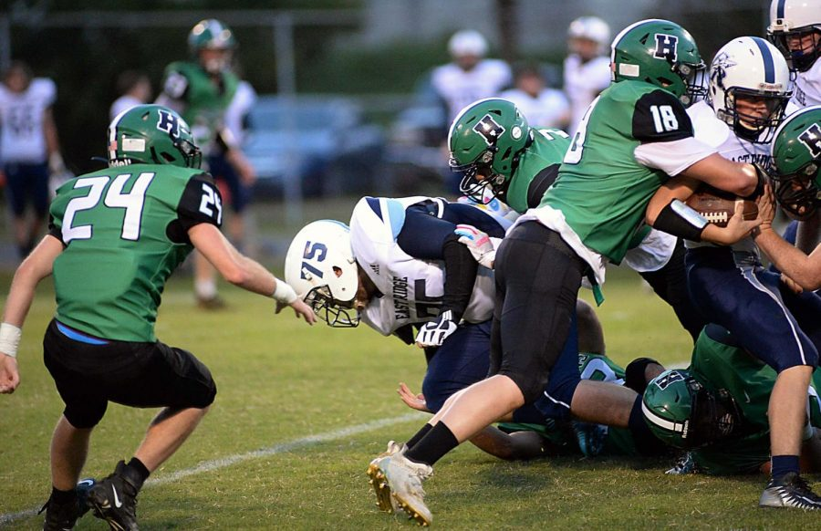 Harlan+senior+linebacker+Dylan+Middleton+and+teammates+brought+down+an+East+Ridge+ball+carrier+in+last+weeks+game.