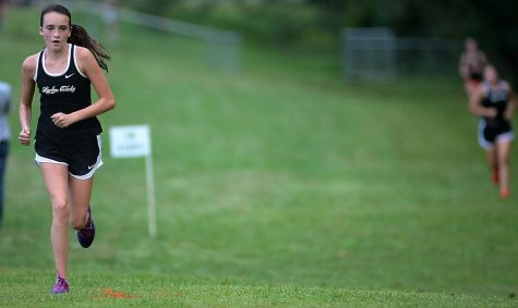 Harlan Countys Sophie Day headed down the hill at the HCHS course on Tuesday on the way to a seventh-place finish.