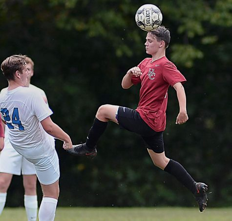Harlan Countys Matthew Jones connected on a header in soccer action Saturday against Estill County.