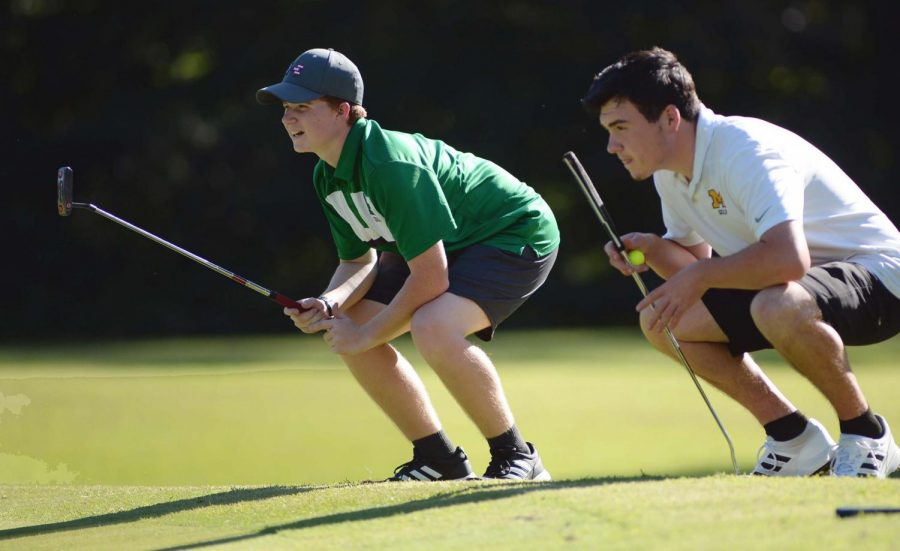 Harlans AIden Johnson and Middlesboros NIck Cox studied the course during a Pine Mountain Golf Conference match earlier this season.