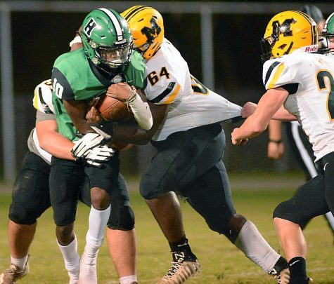 Middlesboro senior tackle Jalil Patterson-Graves and several teammates brought down Harlan quarterback Darius Akal in Friday