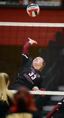 Harlan County senior Lindsey Browning went up for a spike in district volleyball action. The Lady Bears defeated Middlesboro in three sets for their third  straight victory.