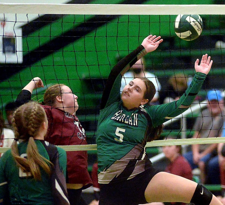 Harlan+Countys+Lindsey+Browning+and+Harlans+Kendyll+Blanton+battled+at+the+net+in+a+district+clash+Tuesday.+Browning+had+15+kills+to+help+lead+HCHS+to+a+four-set+victory.