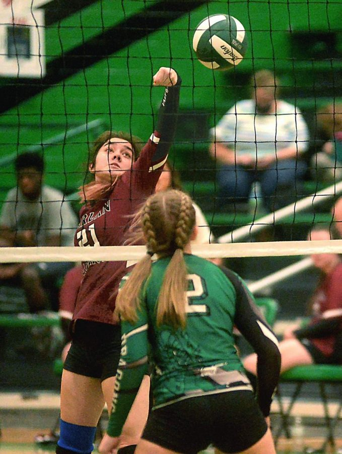 Harlan County senior Serenity Whitehead punched the ball over the net a Harlans Mallory McNiel defended in district volleyball action Tuesday.