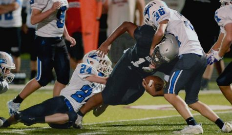 Harlan County running back Shemarr Carr battled for yardage in a game earlier this season. The Black Bears evened their record at 2-2 on Thursday with a 26-14 win at Whitley County.