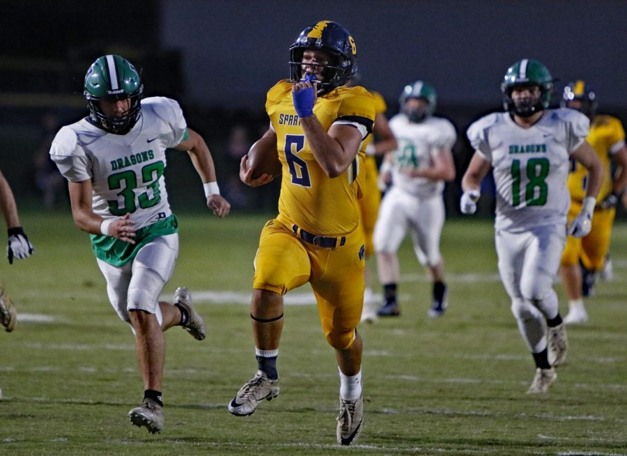 Sayre senior running back Caleb Kern broke free for one of his three touchdowns in Sayres 42-0 win Friday over Harlan.
