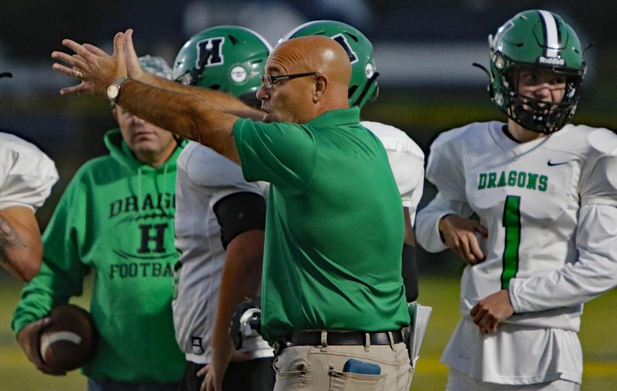 Harlan coach Eric Perry talked with his team during a game in Lexington against Sayre earlier this season. Harlan will open its district schedule Friday at home against Williamsburg.