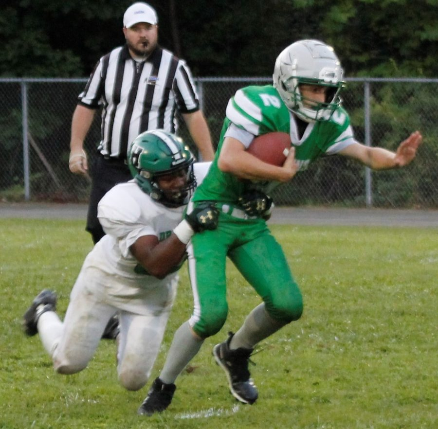 Harlan linebacker R.W. Sanford pulled downed Jenkins Seth Hall for a loss in the Green Dragons 30-0 win on Thursday.
