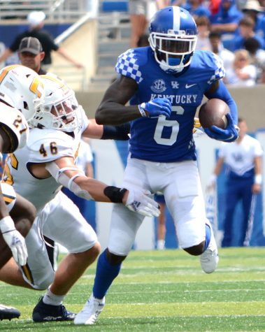 Josh Ali ran for extra yards following a catch in the Wildcats 28-23 win over Tennessee Chattanooga Saturday at Kroger Field.