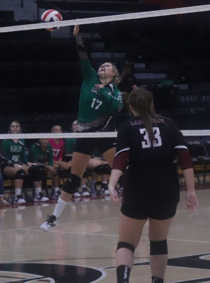 Harlan's Annie Hoskins finished off a point in Thursday's match at Harlan County.