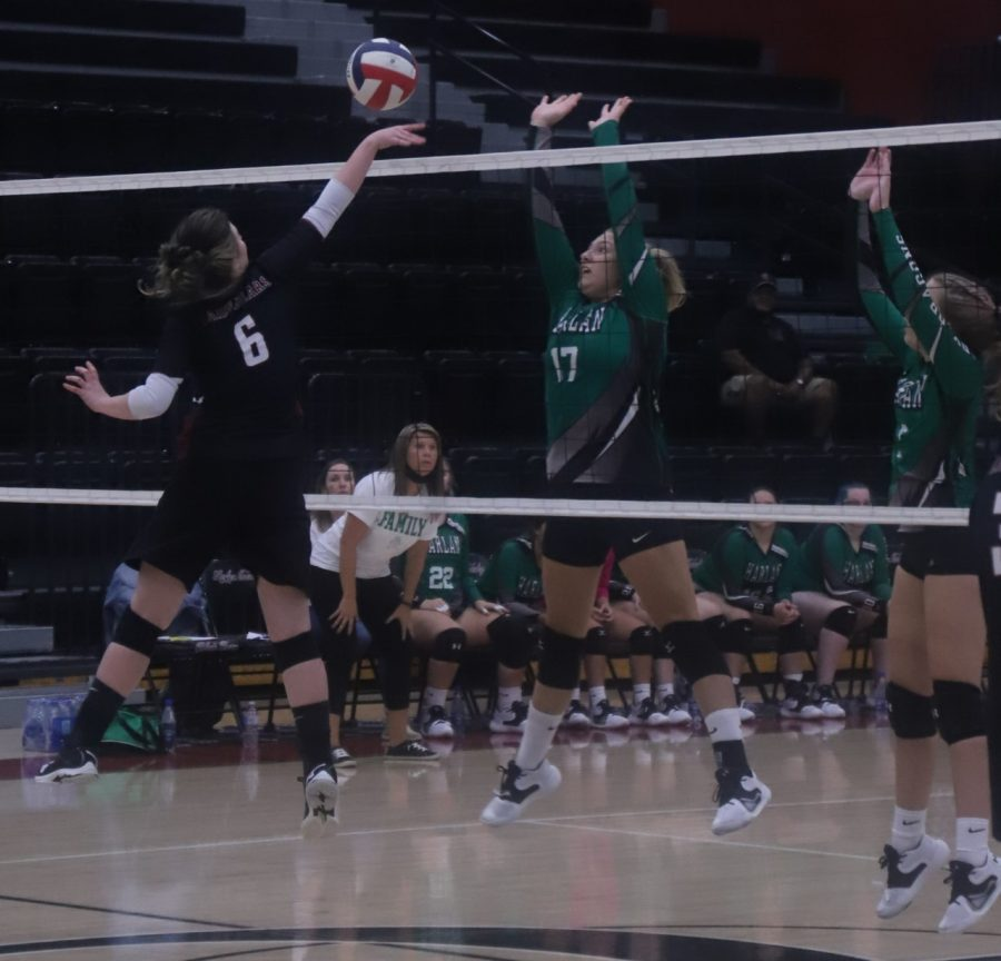 Harlan County's Kalista Dunn went to the net against Harlan's Annie Hoskins in district action Thursday. Dunn led a comeback in the third set as the Lady Bears completed a three-set sweep.