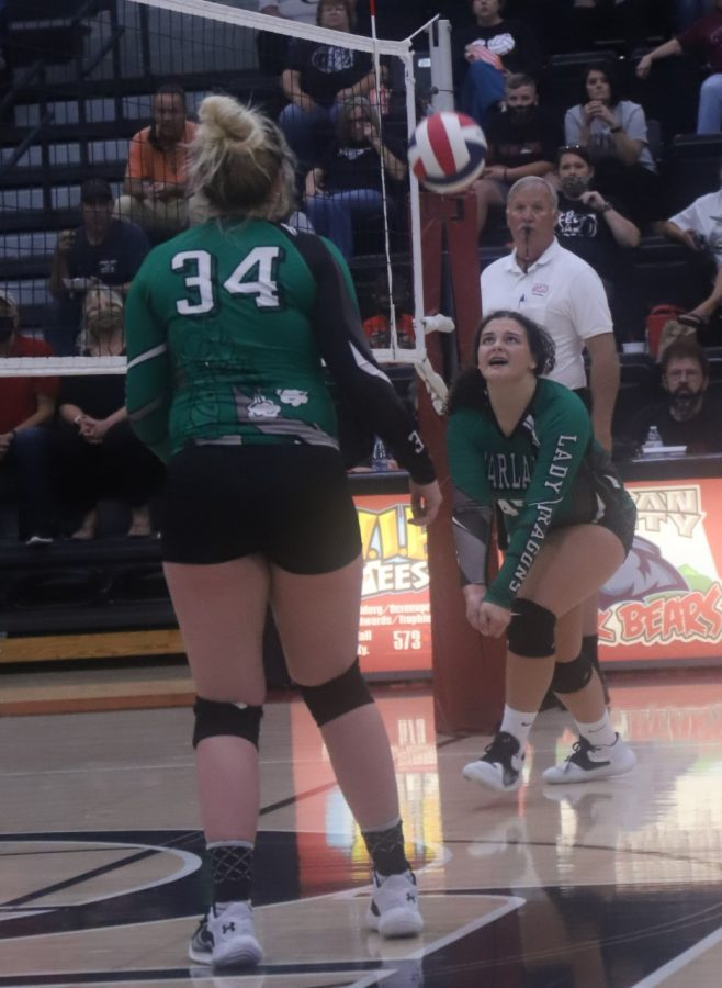 Harlan's Carley Thomas set the ball during Thursday's district match at Harlan County. Thomas reeled off seven straight points to start the third set but HCHS rallied to win in three sets.
