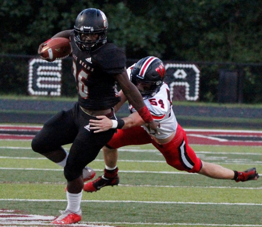 Demarco Hopkins worked to escape from Whitley's Gunner Thornton in Friday's game. Hoskins scored both Harlan County touchdowns in a 42-16 loss. The Bears play host to Knox Central on Friday.