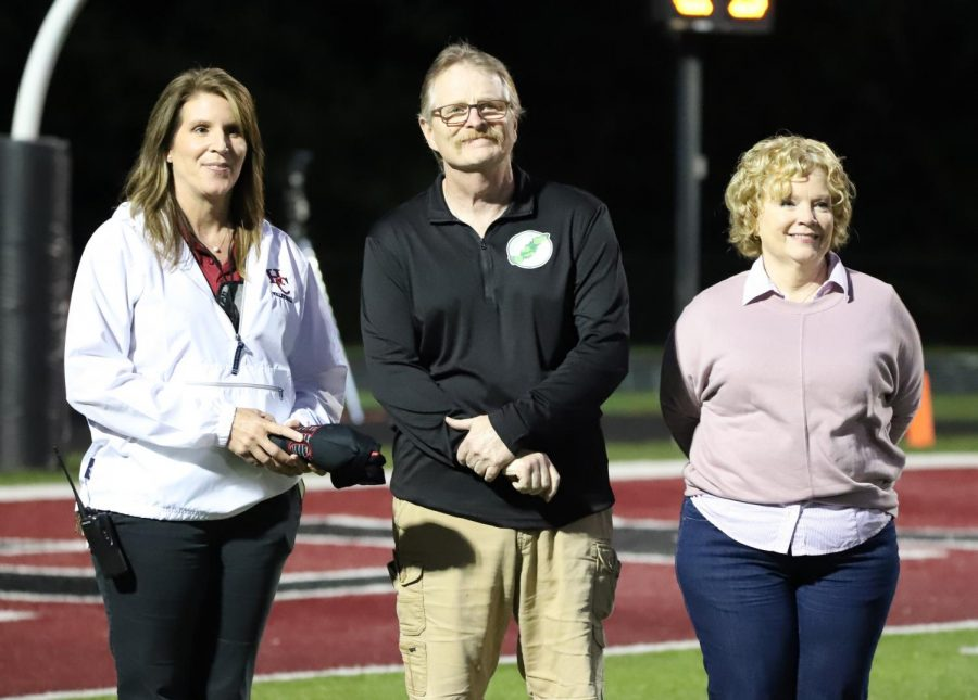Former Evarts coach Bill Musick was honored during Harlan Countys game against Knox Central on Friday. Musick led Evarts to its first and only regional football title and a 13-1 record in 1990. Musick, making his first trip to Coal Miners Memorial Stadium, was presented several HCHS items by Harlan County High School Principal Kathy Napier, who was a student at Evarts when Musick coached there. Musicks wife, Becky, also made the trip to Harlan County.