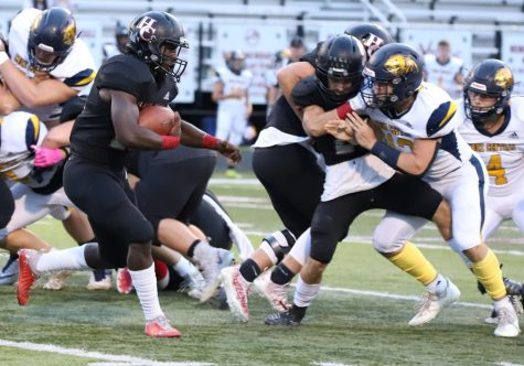 Harlan County running back Demarco Hopkins  looked for an opening against Knox Central linebacker Steve Partin in last week