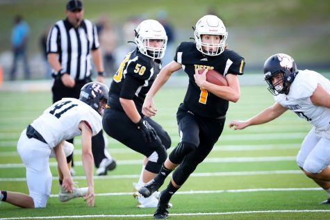 Clay County quarterback Tate Rice broke free for a big gain in Mondays game against Harlan County. RIce threw for five touchdowns in the Tigers 40-20 victory.
