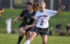 Harlan Countys Leah Taulbee battled for the ball in recent soccer action.