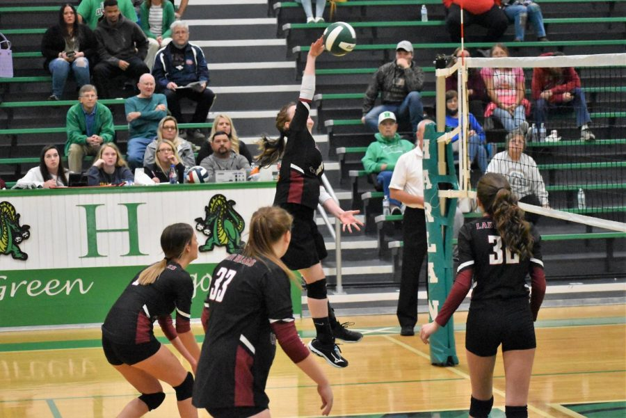 Harlan County eighth-grader Kalista Dunn finished off a point in the Lady Bears win over Harlan on Monday.