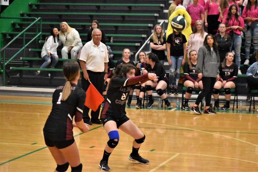 Harlan Countys Serenity Whitehead set the ball in district tournament action Monday. Whitehead led the Lady Bears to a three-set win over Harlan.