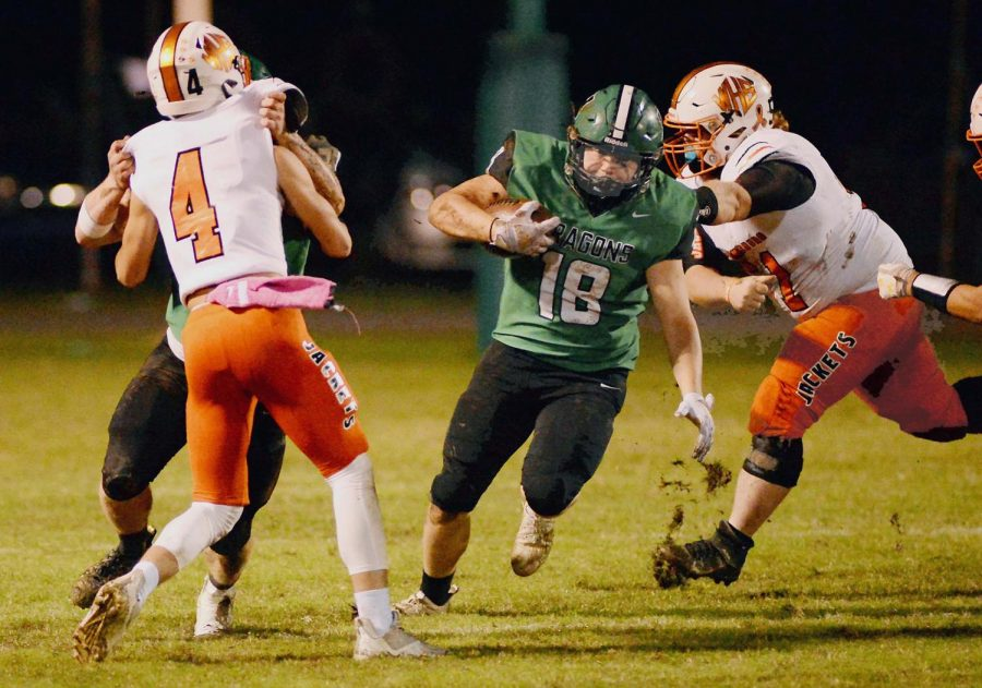 Harlan running back Dylan Middleton found an opening against the Williamsburg defense last week. Middleton scored a touchdown Friday and added three two-point conversions in the Green Dragons 46-22 win at Lynn Camp.