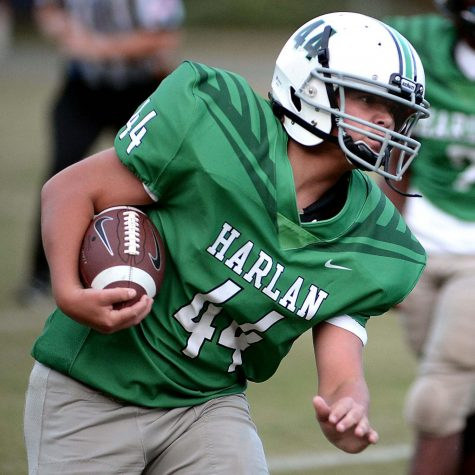 Harlans Baylor Varner battled for yardage against Jackson County in middle school football action. Varner scored two touchdowns in the Dragons 40-38 playoff victory.