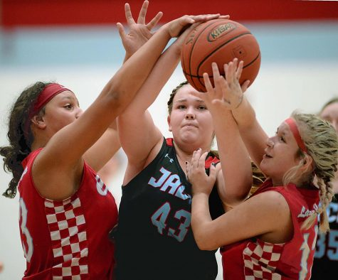Hayley Ward, of James A. Cawood, worked between Cawoods Alley Stewart and Jadelen Bryant in middle school basketball action Thursday at JACES. The visiting Lady Comets won 31-28.