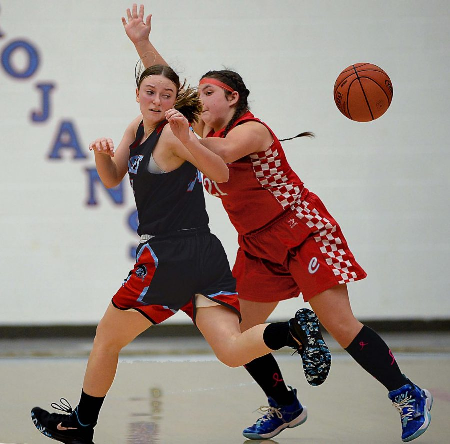James A. Cawoods Jaiden Marlowe battled with Cawoods Katie Smith for a loose ball in middle school basketball action Thursday.