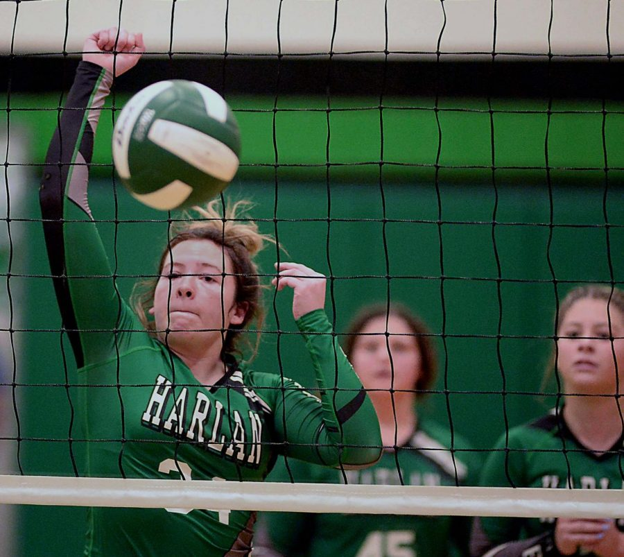 Harlans Marissa Marlowe went to the net in the Lady Dragons regular-season finale Tuesday against Lynn Camp. The Lady Dragons fell in four sets.