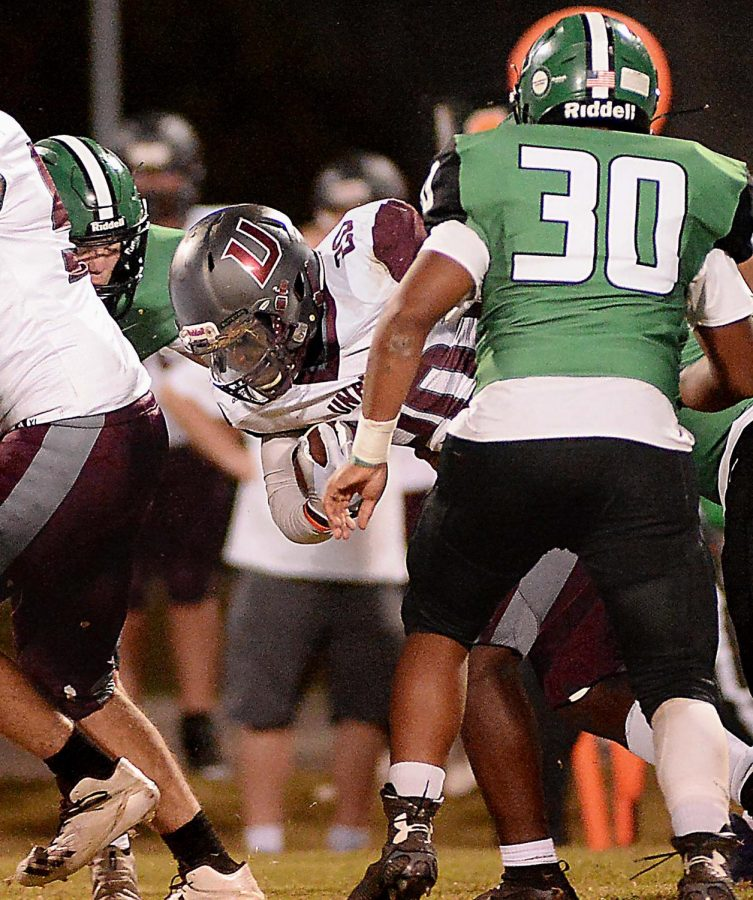 Unaka running back Jamil Blamo battled for yardage in Fridays game at Harlan. Unaka rallied for a 52-34 victory.