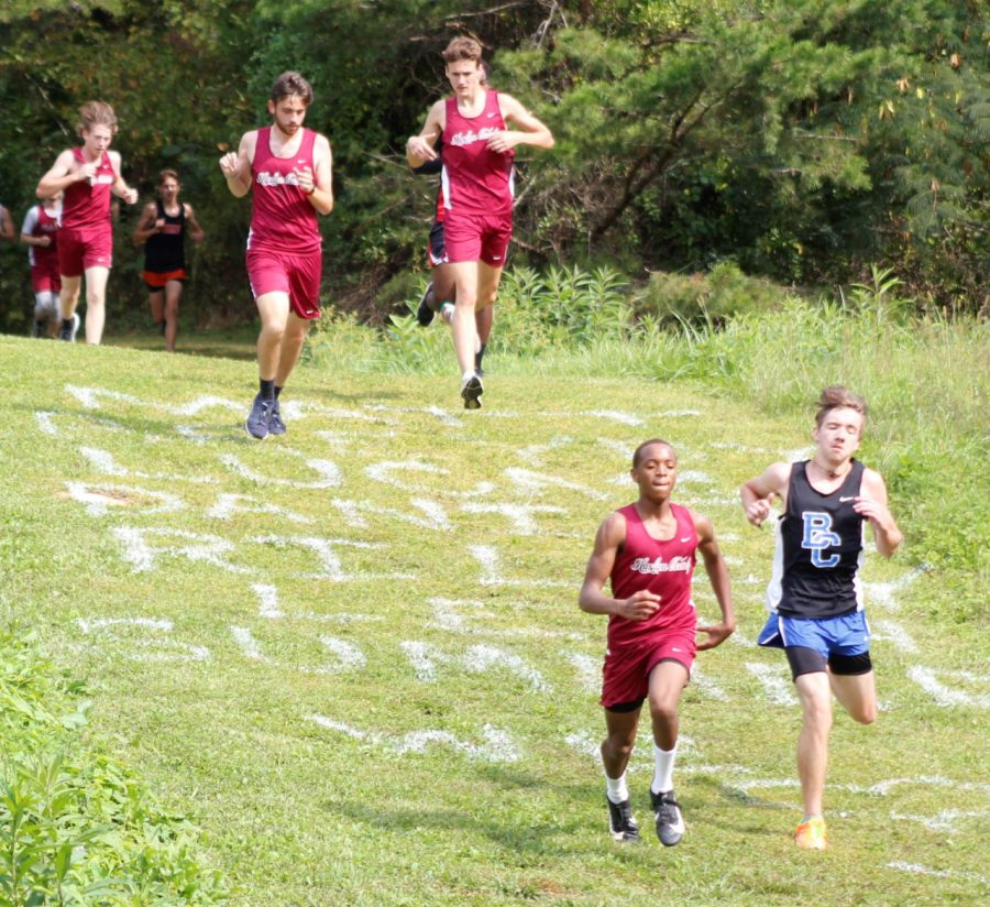 Runners headed down the hill at the HCHS course on Saturday.