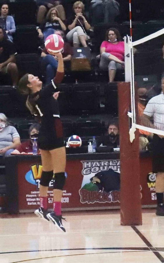 Harlan Countys Lilly Caballero tapped the ball over the net in district action Thursday against Bell County. The visiting Lady Cats won in three sets to clinch the districts top seed.