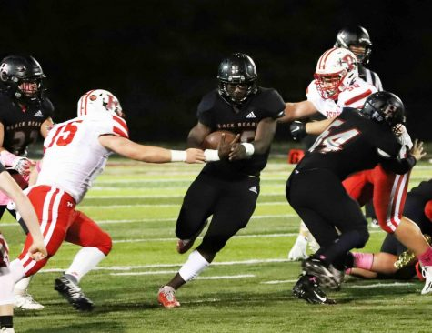 Harlan County senior Demarco Hopkins ran through a hole in the Perry Central defense during Fridays game. Hopkins ran for 171 yards, including a 75-yard touchdown, as the Bears gained 332 yards on the ground.