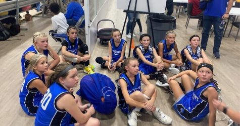 Members of the Rosspoint Lady Cats received instructions during a break in the sixth-grade state tournament in Lexington.