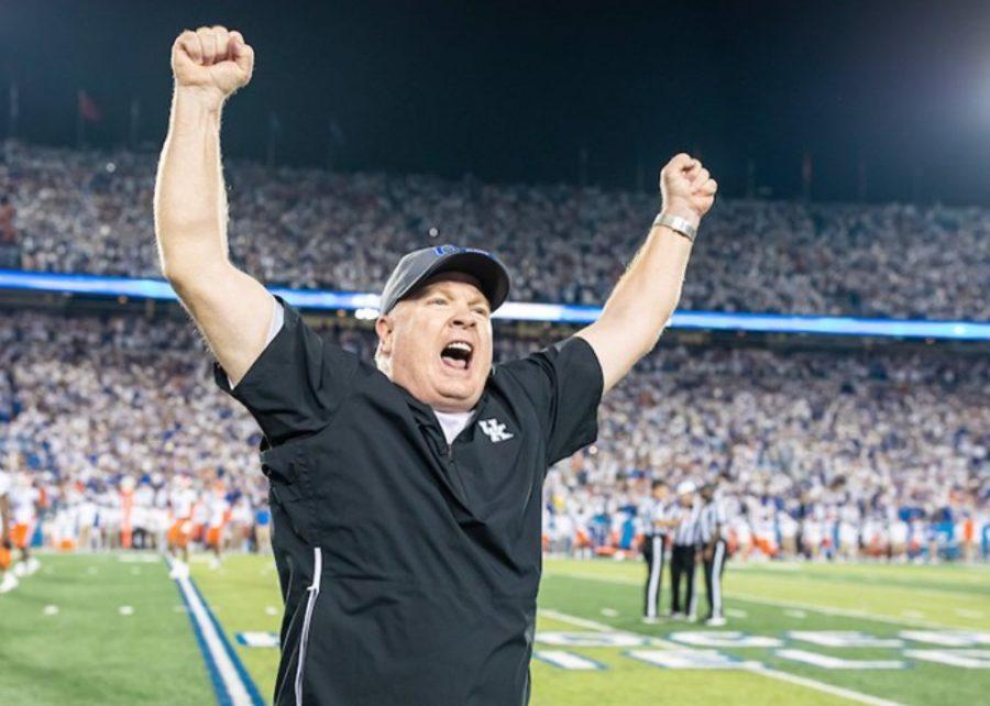 Mark Stoops celebrates Kentuckys win over Florida on Saturday night at Kroger Field.